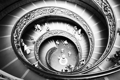 winding down and down (atompz) Tags: above people blackandwhite italy vatican architecture stairs contrast spiral view angle perspective down monochromatic vaticano staircase winding vadican
