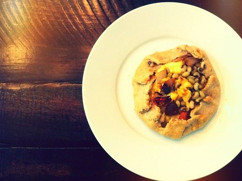 Summer market tart with slow roasted tomatoes and purple hull peas