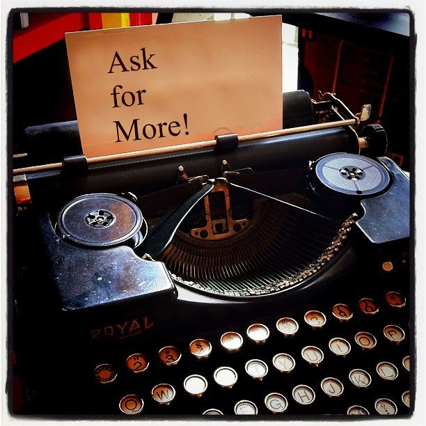 "antique typewriter note that reads ""ask for more"""