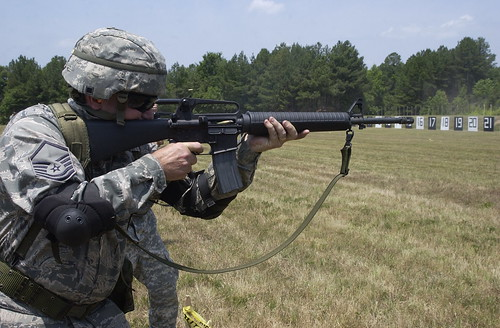 Master Sgt. Darryl Loafman is firing the rifle