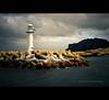 a lighthouse that runs on solar power (© utathyabhadra) Tags: ocean travel sunset sea lighthouse seascape tower topf25 island islands rocks dusk 100v10f korea 500v50f jeju watchtower jejudo cheju chejudo jaeju jaejudo jaejuisland jejudoislands chejudoislands jaejudoisland