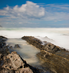 Cloudy Fog (Jurjen Harmsma Photography) Tags: ocean blue sea sky mist fog clouds southafrica coast landscapes rocks exposure blauw colours seascapes air indianocean wolken zee april lucht kust rotsen oceaan kleuren sluitertijd landschappen 2011 airscapes coastalwaters tsitsikamanationalpark zeeschappen luchtgezichten kustwater