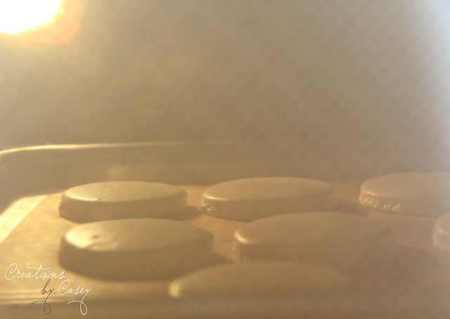 Half baked macaron shells
