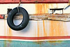 Aged (TTYL8R) Tags: old texture bay boat paint texas tire rusted worn matagorda palacios