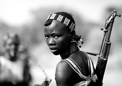 Hamer girl with gun - Omo Ethiopia (Eric Lafforgue) Tags: girl eyes gun arm artistic culture tribal ornament weapon tribes bodypainting tradition tribe ethnic rite tribo adornment pigments ethnology tribu eastafrica thiopien etiopia arme ethiopie etiopa  etiopija 0475 ethnie ethiopi  etiopien etipia  etiyopya  nomadicpeople         peoplesoftheomovalley