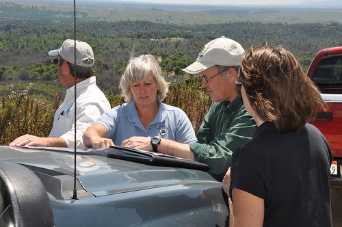 District Conservationist Bob Bailey, Karen Freitas and Forester Jeff Webster working on a forest management plan with the assistance of a sign language interpreter.