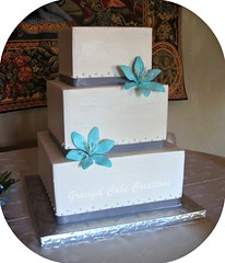 Square Wedding Cake with Stargazer Lilies (Graceful Cake Creations) Tags: flowers blue wedding baby white cake gum square grey paste traditional cream pearls sugar butter tropical ribbon elegant satin simple stargazers elegantweddingcake blueweddingcake whiteandblueweddingcake gracefulcakecreations