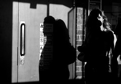Dark side (Jo Dooher) Tags: street shadow bw white black london silhouette nikon candid tube londonunderground nw3 finchleyroadstation d7000