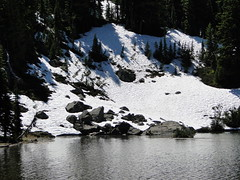 Upper Crystal Lake and snow still on rocks on far bank.