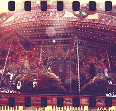 galloping horses (Champignons) Tags: summer horses film 35mm pier holidays brighton fairground kodak carousel diana f amusements sprockets galloping