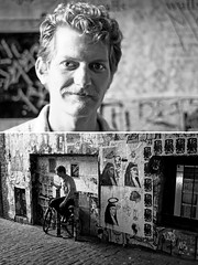 Day 281 of 365 - 1 of 100 Strangers (Andrew.Welker) Tags: seattle portrait bw white black art smile bike wall gum hair photography 50mm 1 washington nikon diptych sitting bokeh 28mm strangers andrew smoking 100 365 smirk say facial graffati 281 d90 welker