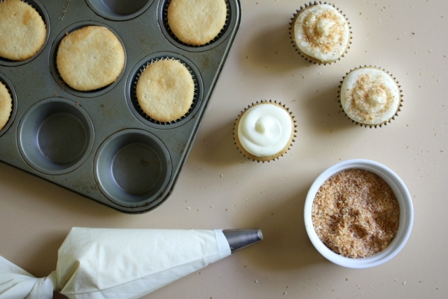 Frosting coconut cupcakes