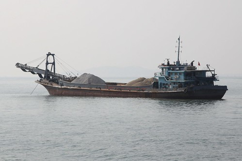 Barge loaded with gravel