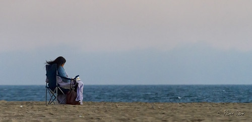Woman sitting on Seal Beach