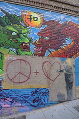 Banksy in SF Chinatown (bswift) Tags: sanfrancisco california sign graffiti peace heart dragons stethoscope dmclx3 p1050196jpg
