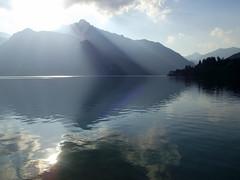 Sun rays (marcoaj) Tags: lake mountains water violet rays sunrays movements trentino ledro lagodiledro marcoajelli
