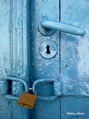 the golden lock - Chora, Andros, Greece (dimitra_milaiou) Tags: world life door wood blue houses sea 2 two people house color home colors wall architecture painting island greek gold one 1 golden design living nokia wooden europe paint industrial day colours village time lock aegean hellas lifestyle greece hora gloss shape pure chora andros cyclades dimitra hellenic x6  linescurves kyklades   aigaio    milaiou
