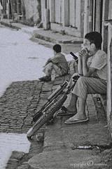 nostalgia of childhood (EG documentary photography) Tags: children istanbul boredom nostalgia heat filmgrain balat noonday