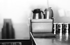 (Leit Rosewater) Tags: summer vacation blackandwhite white black film coffee shop 50mm nikon break asheville grain cream northcarolina f18 nikonf3 doubledeckerbus filmgain