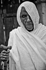 Old woman in Gondar, Ethiopia (NeSlaB .) Tags: world poverty africa old portrait blackandwhite woman canon easter religious photo blackwhite eyes women dress faith religion clothes celebration oldwoman ethiopia rite pilgrim rites developingcountries reportage pilgrims holyweek etiopia gondar gonder amhara thirld neslab