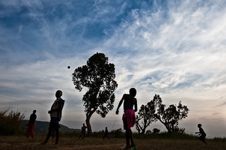 Lendu children playing football at the sunset - DR CONGO -