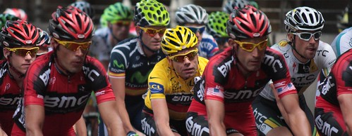 Cadel Evans – surrounded by his BMC teammates – rides into Paris to claim the 2011 Tour de France. Photo: Siobhán Silke
