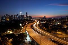 Kay-El! (Ming Jun Tan) Tags: city longexposure blue sunset sun cars set skyline lights twilight highway asia southeastasia cityscape dusk malaysia twintowers lighttrails bluehour kualalumpur cityskyline kltower petronastwintowers