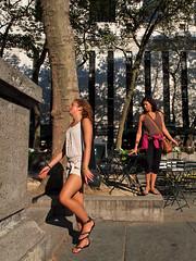 and now we dance (zlandr) Tags: street city nyc newyorkcity urban newyork streets vertical manhattan candid olympus sp gesture bryantpark 44 unaware ep1 spnp streetphotographynowproject chrisfarling zlandr instruction44