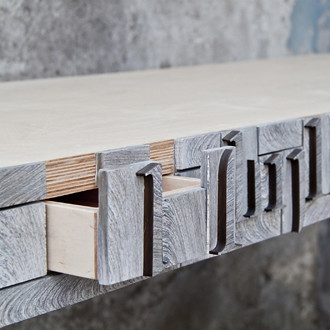NewspaperWood table with open drawer