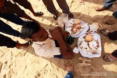 Gather Around (Srujan Chennupati) Tags: music shells seashells marketing sand shoes legs blowing plastic marinabeach chennai selling seller plasticbags hawker buying displaying streethawker