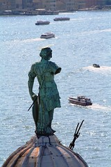 The damaged statue (Bozzzyy) Tags: venice sea italy sculpture green art broken water statue architecture bronze boat missing arm taxi copper watertaxi fallenoff