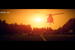 Hangar Road (Jeff Krol) Tags: road light sunset cinema cars canon eos warm mood aircraft military air hangar flight stripe special landing helicopter airforce cinematic f28 heli hovering leeuwarden 70200mm luchtmacht klu 70200l ef70200mmf28lusm luchtmachtdagen 60d img3962 jeffkrol