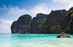 Maya Bay (Jim Boud) Tags: ocean travel blue vacation cliff seascape water clouds movie landscape thailand islands colorful asia southeastasia paradise tour turquoise relaxing vivid wideangle flags cliffs thai tropical tropicalisland colourful lush phuket efs cliche thebeach lightroom leonardodicaprio artisticphotography superwideangle cliché asiapacific phiphiislands mayabay phuketisland phiphiley jimboud thebeachmovie canoneos60d jamesboud canonefs1585mmf3556isusm canon1585mm