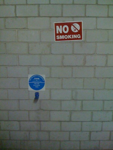 No Smoking! The fire extinguisher is missing!