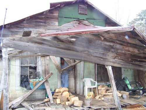 "The ""before"" photo of the old home of Ms. Monger in Grenada, which was a hazard."
