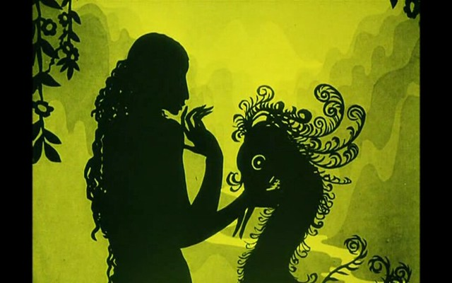 a black shadow puppet of a woman holding a  bird against a yellow background