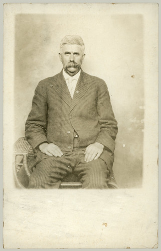 Man in one arm chair
