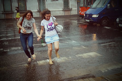 The rain at Ukraine :-) (Che-burashka) Tags: road street summer people girl rain weather shower jumping crossing candid run ukraine skipping puddles easterneurope lx3