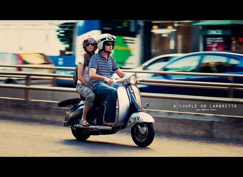 A couple on Lambretta by raul gonza|ez