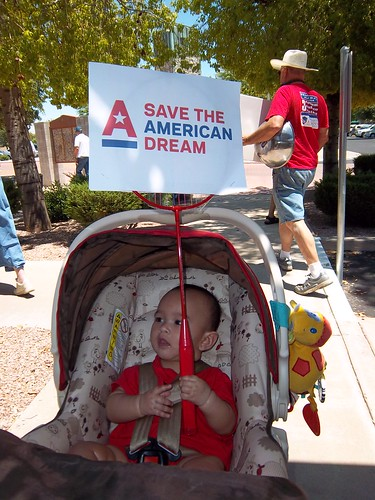 Little one holds up a sign to Save the American Dream