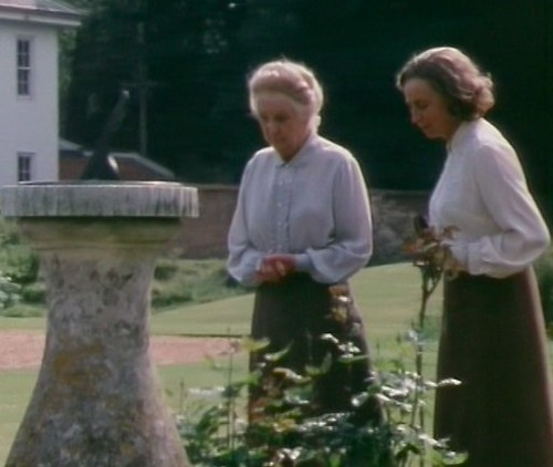 Miss Marple and Mrs Bantry in the garden, wearing very similar long skirt and white shirt