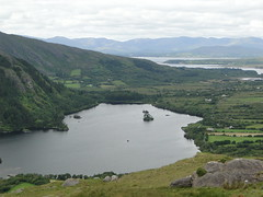 View from close by the Healy Pass (gowersaint) Tags: ocean trees ireland houses sea wild irish sunlight lake mountains water clouds landscape islands rocks moody stones atmosphere windy atlantic shore farms celtic rough agriculture kenmare cottages countykerry i