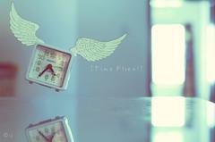 Time Flies (Crosshatchs) Tags: longexposure macro reflection green art clock colors angel lights design wings nikon aqua soft interiors dof time smooth quotes crossprocessing pastels dreamy concept closeups tabletop crosshatch 50mm18d bokehlicious zeejay bokehs d7000