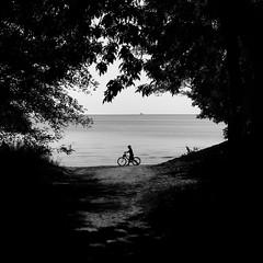 Up The Beach (Lucem~Ferre) Tags: boy summer white lake ontario canada black beach bike burlington canon boat cool mark horizon ii 5d lakeontario 2470mm cool2 cool5 cool6 cool4 burlingtonontario cool7 iceboxcool unanicool coolthree f64g36r2win f64g36champ