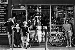 ~  la boulangerie ~ (Janey Kay) Tags: summer paris film waiting sommer streetphotography bikes fujifilm analogue bp t boulangerie argentique bakers vlos nikonf301 filedattente parisplages janeykay samyang85mm14