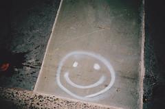 (▲brian james) Tags: life nyc film face 35mm concrete graffiti paint sidewalk smiley cz adventures brianjamesphotography httpbrianjamesphotographynet