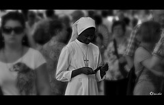 When God's calling [Street in Verona/70-300mm][EXPLORE Jul 11, 2011 #52] (dClaudio [homofugit]) Tags: street italy black nikon call god sister african meeting nun verona mobilephone 70300mm calling vocation eidos answering d90 mygearandme