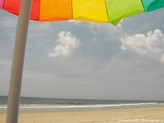 A Day at the Beach (Studio281Photos) Tags: summer beach nature umbrella rainbow sand shoreline northcarolina beachumbrella holdenbeach