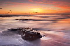 Calm End (Mark Emirali) Tags: ocean longexposure light sunset sea newzealand sky cloud seascape blur colour reflection art nature water clouds canon landscape flow rocks mood auckland nz canon5d westcoast aotearoa copyrighted maoribay pleasedonotusewithoutmypermission 5dmkii markemirali rocksandsunset markemiraliphotography
