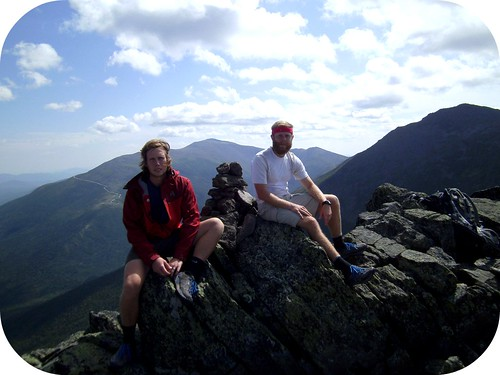 Sitting on Mt. Madison with big ole' Washington in the background
